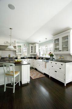 white kitchen, glass cabinets, dark counter tops, farm sink - love!