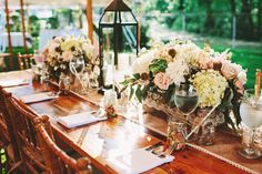 I LOVE EVERYTHING about the look of this table: more garden non-organized flower centerpieces, the base the flowers are in, the flower colors, the lantern, the burlap/lace stuff, mason jars