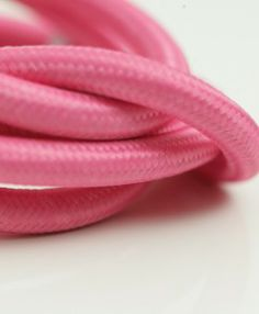 Plush pink smooth fabric cable is a fun, bright addition to your decor plan.