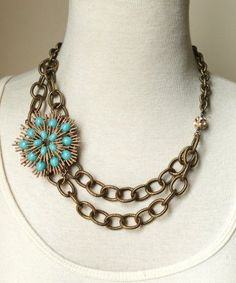 "Antique gold etched chain, vintage brooch and rhinestone beads. Length: 18""  $139"