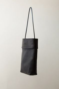 """Bag: Midnight Easy Tote - leather (15 x 11 x 3.5"""") - Chiyome $360  Black veg tanned and midnight blue leather exterior with black cotton lining. Black rubber square cord. Brass magnet closure. Interior pocket, hand painted edges.  Each bag is made by hand."""