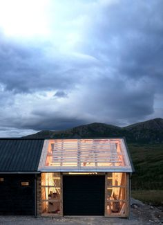 A transparent garage at one end of the cabin provides the family a place to leave their gear before they pass though a laundry area, bathroom and kitchen.