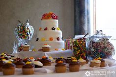 Wedding cake displayed with a candy buffet and cupcakes    Cute. Ambrosa, click on that pic until it takes you to the site. Lots of ideas but couldn't pin from site...
