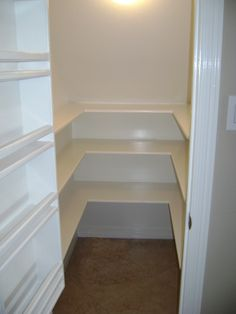Pantry under stairs-- Even the door has storage!