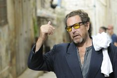 "Julian Schnabel is an American artist and filmmaker. In the 1980s, Schnabel received international media attention for his ""plate paintings""—large-scale paintings set on broken ceramic plates. artist, julian schnabel"