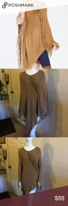 BCBGMAXAZRIA fringe poncho Ultra soft ribbed knit poncho with fringe trim detail. Pullover style, knee length. Made of 100% acrylic. hand wash cold BCBGMaxAzria Jackets & Coats Capes