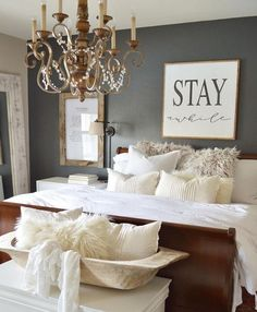 Easy ways to create a cozy bedroom including faux fur, lots of pillows, cozy blankets, hanging plants, canopies, tapestries, hanging lights and more!