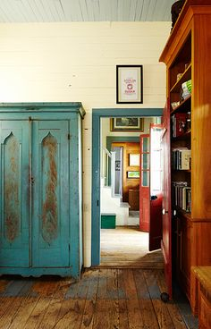 A painted armoire is now used as a pantry in the family's kitchen. #southernhomes (Photo Credit: Brie Williams) #GardenandGun