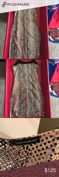 Dolce & Gabbana snakeskin w/silver body con This dress is hot.  Snakeskin with silver shimmers.  This is an attention grabber.  You won't find this baby anywhere. I held on to it a bit too long, I don't really get to wear stuff like this anymore, mom life!  It has silver spaghetti straps with the d&g logo in front. It hugs every curve and fits like a glove.  True to size.  I will try to post better picks I used the little dude's slide.  From a smoke and pet free home Dolce & Gabbana Dresses…