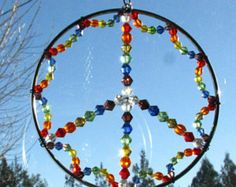 Rainbow Peace LGBT SunCatcher by CelestialWoodlands on Etsy Wire Crafts, Bead Crafts, Faceted Glass, Glass Beads, Sun Catchers, Dream Catchers, Pine Needle Baskets, Diy Wind Chimes, Hanging Crystals