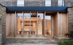 London-based O'Sullivan Skoufoglou Architects have transformed a Dewsbury Road home, with an extension characterised by warmth and minimal wooden design. Architecture Extension, London Architecture, Residential Architecture, Contemporary Architecture, Minimalist Architecture, London Townhouse, London House, Casa Atrium, Design Minimalista