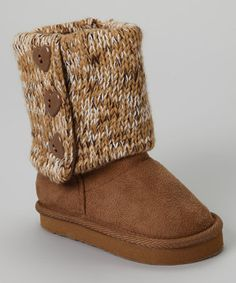 When cool breezes threaten to ruin a playdate, reach for these soft and cozy boots. A toasty interior, side zipper and durable soles keep feet warm and snug, while the knit cuffs and decorative heart-shape buttons give toes a sweet and stylish kick.
