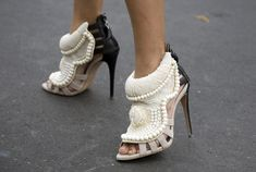 Giuseppe Zanotti for Kanye West -- this style looks confused (a winter slipper for evening wear?)