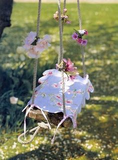 garden swing decorated for photography sessions with granddaughters...looks simple enough and would be a lovely setting