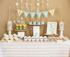 Bundle Up, Baby! Dessert Table. Keep things simple with colorful decorations with puddings, cupcakes and sweet and crunchy caramel corn.