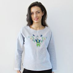 Oversize blouse with embroidered patterns in Kashubian is made of thick fabric.