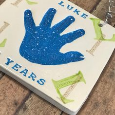Hand print impression in clay with speckled blue hand and upper/lower case initials. Baby Hand And Foot Prints, Hand Prints, Baby Hands, Pottery Studio, Lowercase A, Footprint, Initials, Arts And Crafts, Clay