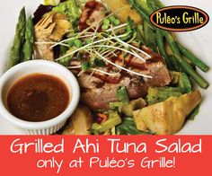 #Puleosgrille Grilled Ahi #Tuna #Salad.  Grilled ahi tuna on a bed of spring greens with #asparagus, sprouts, and marinated artichokes with a soy ginger dressing.