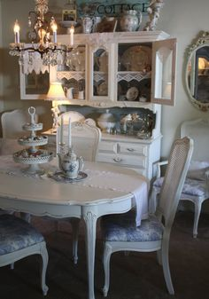 Shabby Chic Dining Room. I really love the table and chairs.