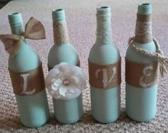 Teal chalk painted wine bottles with twine and metal flowers Bottle Glasses Diy, Diy Bottle, Bottle Art, Painted Wine Bottles, Bottles And Jars, Glass Bottles, Wine Bottle Centerpieces, Personalized Wine Bottles, Decorated Wine Glasses