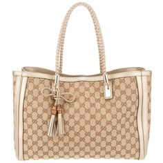 This is my favorite summer tote.  It's light weight and beautiful. Have to be careful not to get ot dirty though.....GUCCI 'bella' tote