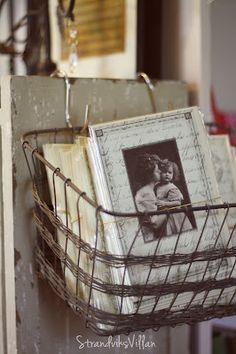 wire basket. Love the idea of  vintage pictures and old letters