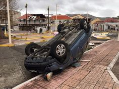 The devastating hurricane pulverised the island of Saint Martin, ripping roofs off buildings, flipping cars over and flooding roads
