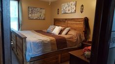 California King headboard / footboard with 4 drawer chest underneath for storage...pallet wood with some rough lumber slabs used for frame and cross braces
