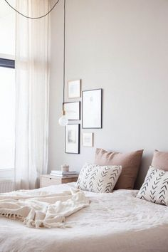 feminine bedroom with art collection                                                                                                                                                                                 More