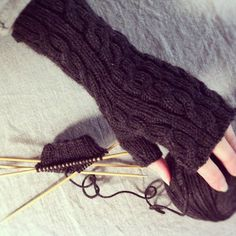 my cabled handwarmer pattern, knit in a rich espresso shade by a friend.