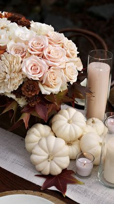 White pumpkins! And blush roses. Love this new color twist on fall table decor so much better than browns and oranges.