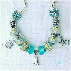 Caribbean breeze charm bracelet European style charm bracelet, representing bare feet by the ocean. Premium quality; Detailed ocean colored glass beads crystal and tibetan silver spacers all perfectly blended together and placed on this silver plated snake chain. This can all pair seemlessly w all name brands and are interchangeable. Available on a silver plated cuff/bangle, stainless cuff/bangle or leather. Discounts given on bundles, custom orders welcome. Salty Grace  Jewelry Bracelets
