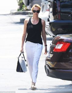 Simply stunning: Charlize Theron managed to make a pair of casual trousers look glamorous as she headed to a work meeting in Santa Monica on Thursday