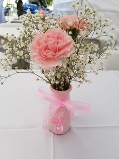 Easy to Make Baby Shower Decorations on a Budget - Coffee Filter Topiary Centerpiece - Baby shower centerpiece Milk bottles babys breathe and carnations Love them - Cute Baby Shower Ideas, Baby Girl Shower Themes, Girl Baby Shower Decorations, Baby Shower Princess, Babyshower Themes For Girls, Baby Shower Favors Girl, Shower Baby, Butterfly Baby Shower, Baby Shower Flowers