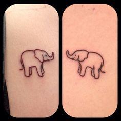 Matching elephant tattoos