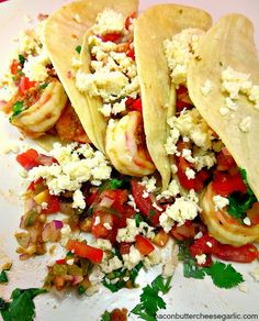 Mojo de Ajo Shrimp Tacos...these tacos have as much mojo as Austin Powers!  Mojo de ajo is a garlic sauce.  And these tacos are served with fresh pico de gallo and cotija cheese!  Yummy!
