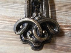 """This is vintage style iron door knocker. The design is either an Celtic or pattern design. It is made of cast iron. Heavy. Measurements: 8 1/2"""" H 3 1/2"""" W"""