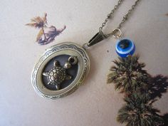 Bronze Oval Turtle Locket NecklaceEvil Eye Locket by PrettyDIY, $13.00