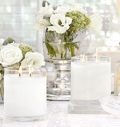 Glasshouse candles scattered around for scent
