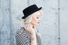 www.theredclosetdiary.com || Fashion blogger wearing a black and white striped dress with black booties and a black hat with platinum hair!