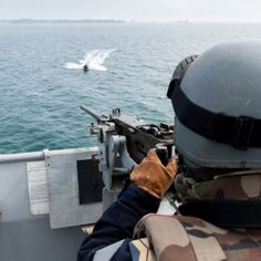 Gunner at 12.7mm  takes aim at a similuated terrorist threat, from French Marine Nationale ship Siroco, during Franco/German Execise Spontex 2013, in May, in the Atlantic Ocean.