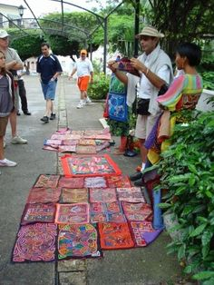 """Selling """"Mola"""", intricate reverse applique crafts, created by the Cuna tribe of the San Blas Islands, Panama #panama #mola"""