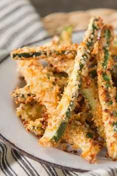 Chris' mom made these and they were awesome! Made me actually like zucchini. Crispy Oven Zucchini Fries Recipe ~ Recipe Courtesy of Paula Deen I got so many zucchini im trying these!