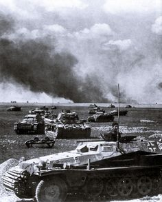Probably one of the best know photos of Operation Barbarossa showing an attack of Panzerwaffe units across open fields.In the foreground is a Sd.Kfz. 253 armored command vehicle,as a leading command post of a tank unit composed of Pz.Kpfw. IIs and IIIs and supported by infantry hidden in their Sd.Kfz. 251s.