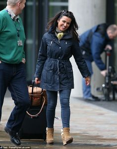 That's a big smile: Susanna Reid looks happy as she leaves Media City in Manchester after hosting the BBC Breakfast show Suzanne Reid, Good Morning Britain, Celebrity News, Manchester, Bbc, Military Jacket, Winter Jackets, Weather, Leaves