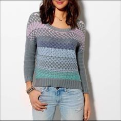 AEO Multi Color Gray Sweater Perfect colors to go with your favorite jeans. Multi colors on front solid gray back. Cozy 100% soft cotton knit. Easy fit. Slight hi-lo hem. Ribbed crew neck, cuffs and hem. So nice you'll think it's brand New💕 American Eagle Outfitters Sweaters Crew & Scoop Necks