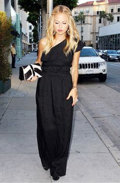 Rachel Zoe in a black gown with beachy waves.