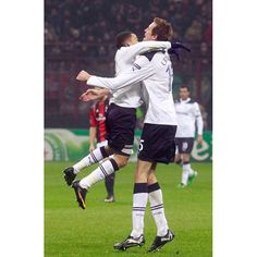 Tottenham Hotspur's Peter Crouch celebrates with his team mate Aaron Lennon after scoring against AC Milan during their Champions League soccer match at the San Siro stadium in Milan