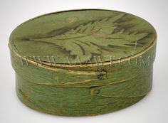 Pantry Box, green paint  With Stencil Decoration  Signed Sprague  Hingham, Massachusetts  Small oval tack-and-peg constructed Bent-wood box in original paint.  (Height: 1.75 inches; width: 4.25 inches; depth: 3.25 inches.)