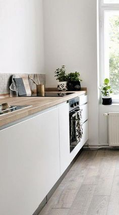 Love everything about this kitchen. Wooden bench tops, floor and cabniets